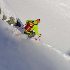 Freeride skiing with a guide