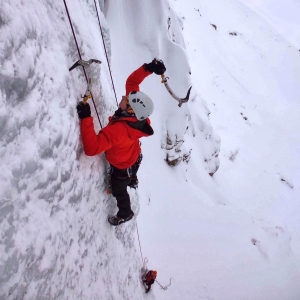 Ice climbing with a guide